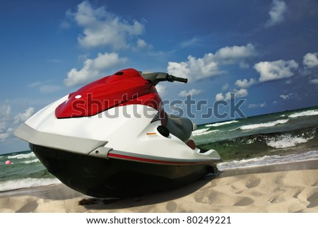Jet-ski lies on the shore