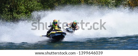 Jet Ski Racers in competitive event on lake making a lot of spray. #1399646039