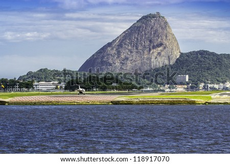 Jet taking off against Sugar Loaf mountain in Rio de Janeiro