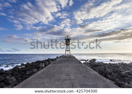 jetty and lighthouse in Saint Pierre, La Reunion island, Indian Ocean, april 26, 2016,  Saint Pierre, France