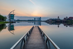 Jetty at lakeside with beautiful sunrise at Pullman, Putrajaya, Malaysia.