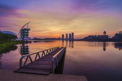 jetty at lakeside with colorful sunrise. Pullman, Putrajaya, Malaysia