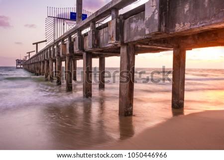 jetty beach jetty sunset #1050446966