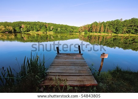 Jetty on a lake - stock photo