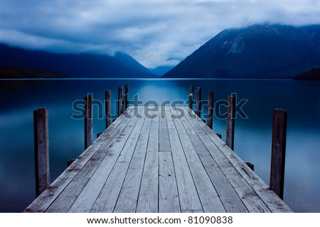 Jetty on a mountain lake #81090838