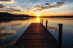 Jetty on Kochlsee in the Bavarian Alps in the sunset