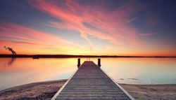 jetty sunset, wooden Pier on the lake, winter