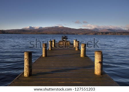 jetty with mountains in background