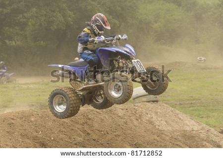 "JEVICKO, CZECH REPUBLIC - JULY 23. Unidentified racer jump a quad motorbike in the ""Crossracing Cup 2011"" on July 23,  2011 in the town of Jevicko, Czech Republic."
