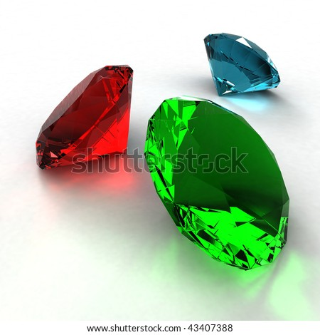 Jewel diamond of green, blue and red color on a white background