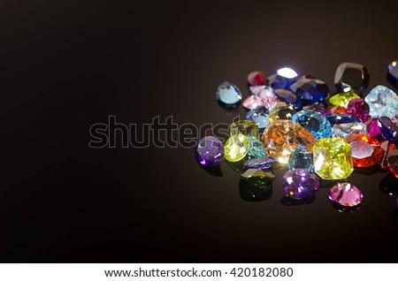 Jewel on black shine color, Collection of many different natural gemstones \ amethyst, lapis lazuli, rose quartz, citrine, ruby, amazonite, moonstone, labradorite, chalcedony, blue topaz