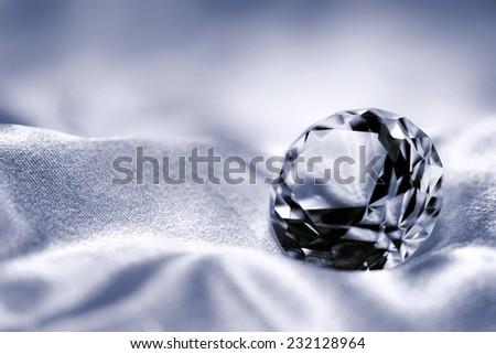Jewel on satin fabric background