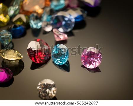 Jewel or gems on black shine color, Collection of many different natural gemstones amethyst, lapis lazuli, rose quartz, citrine, ruby, amazonite, moonstone, labradorite, chalcedony, blue topaz #565242697