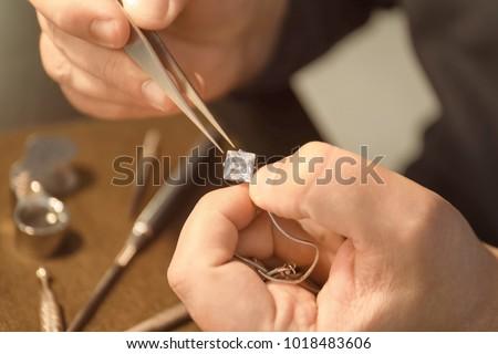 Jeweler working in workshop, closeup Сток-фото ©