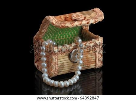 Jewelery box with necklaces - stock photo