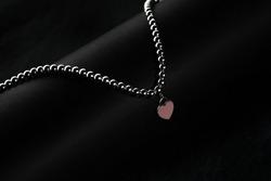 Jewellery bracelet on black tube curving