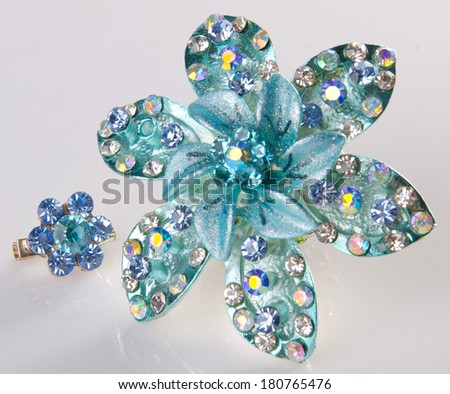 jewellery. brooches on the background