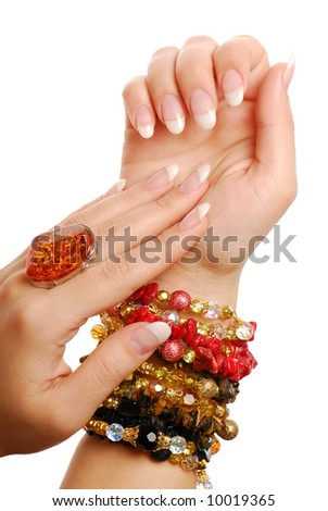 Jewelry and gems. Elegance woman fingers and nails.