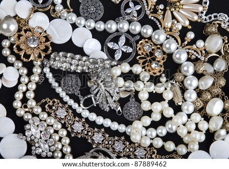 Jewelry background. Many beautiful jewelery