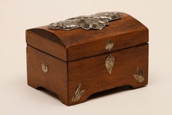 Jewelry box made of wood with additional workmanship and decorated. Wooden jewelry box. Wooden box made of aged wood.