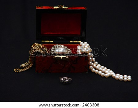 jewelry box overflowing with jewelry