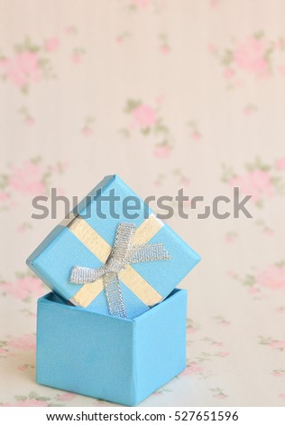 Jewelry box with white gold and silver rings, earrings   - Shutterstock ID 527651596