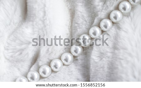 Jewelry branding, elegance and sale concept - Winter holiday jewellery fashion, pearl necklace on fur background, glamour style present and chic gift for luxury jewelery brand shopping, banner design #1556852156