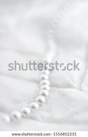 Jewelry branding, elegance and sale concept - Winter holiday jewellery fashion, pearl necklace on fur background, glamour style present and chic gift for luxury jewelery brand shopping, banner design #1556852231