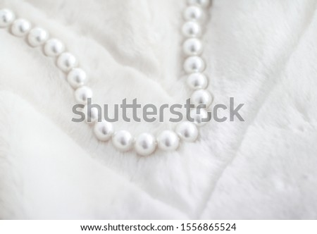 Jewelry branding, elegance and sale concept - Winter holiday jewellery fashion, pearl necklace on fur background, glamour style present and chic gift for luxury jewelery brand shopping, banner design #1556865524