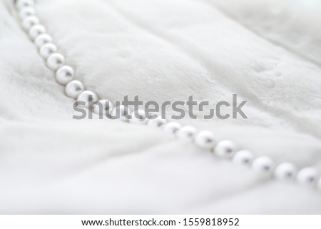 Jewelry branding, elegance and sale concept - Winter holiday jewellery fashion, pearl necklace on fur background, glamour style present and chic gift for luxury jewelery brand shopping, banner design #1559818952