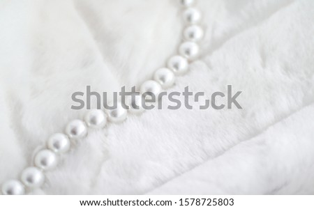 Jewelry branding, elegance and sale concept - Winter holiday jewellery fashion, pearl necklace on fur background, glamour style present and chic gift for luxury jewelery brand shopping, banner design #1578725803