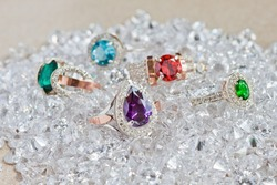 Jewelry golden rings with colored diamond stones on white diamonds