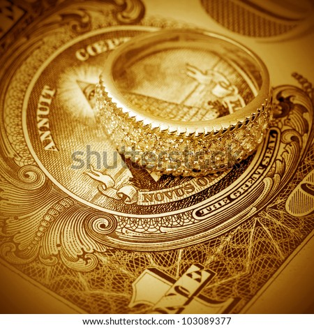 Jewelry on a background of  dollars close- up - stock photo