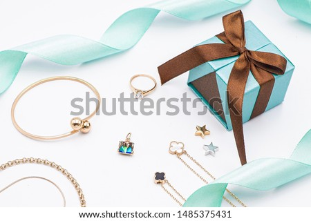 Jewelry present, ring, necklace, bracelet, chain, tiffany string.