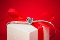 Jewelry silver charm bracelet on the gift box. Small heart. Best gift for Valentines Day and Mothers day. 8 march. Engagement and wedding. Gift favorite.