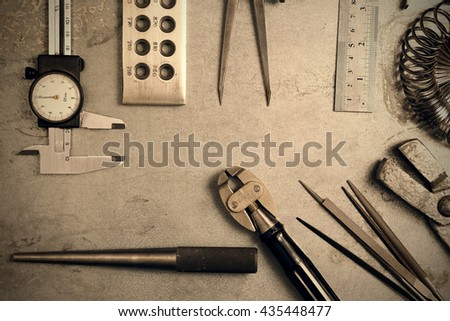Jewelry tools. Jewellery workplace on metal background. Top view. Toned image