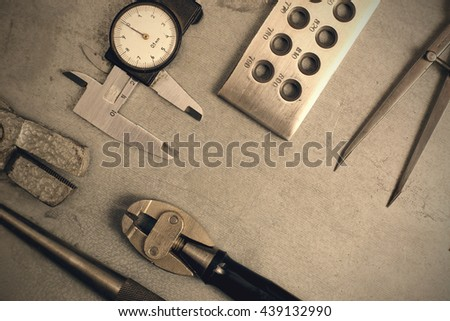 Jewelry tools set. Jewellery workplace on metal background with copy space for text. Top view. Toned image