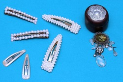 Jewelry wooden box with diamond brooch and pearls hair pins retro fashion accessories