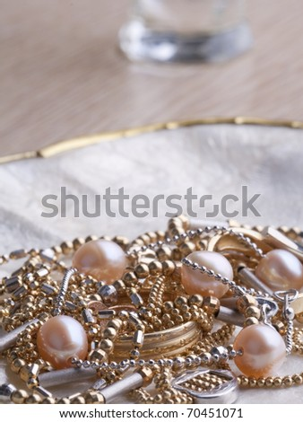 Jewels in a nacreous shell on a dressing table