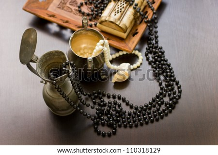 Jewels in a nacreous shell on a dressing table/Still life with wooden treasure chest with pearl necklaces./ pearl necklace and seashell over stones