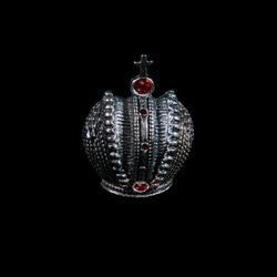 Jewerly crown with rubies closeup