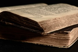 Jewish Bible. Selective focus. Old worn Jewish books. Opened scripture pages. Closeup