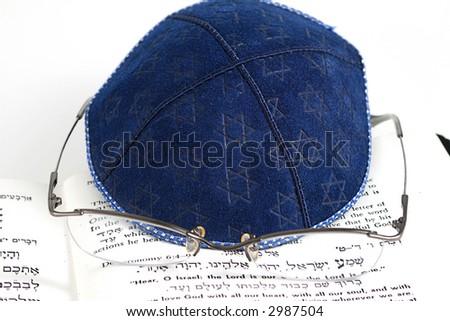 Jewish blue kippah, eyeglasses and shema (Jewish Prayer)