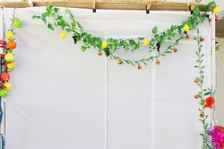 Jewish festival of Sukkot. Traditional succah (hut) from white fabric and colorful decorations