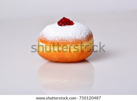 jewish food holiday Hanukkah symbol image of donut with jelly and sugar powder. isolated .