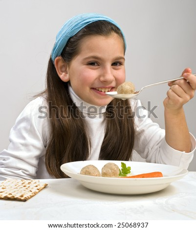 Jewish girl eating a matzo ball soup in passover