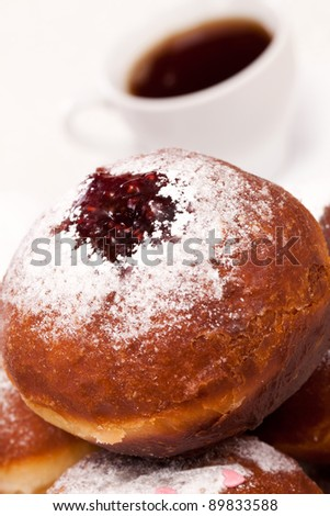 Jewish holiday baking donuts with syrup