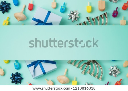 Jewish holiday Hanukkah background with menorah,  gift box and spinning top. Top view from above. Flat lay