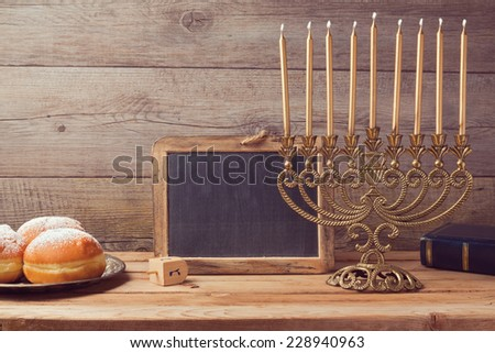 Jewish holiday hanukkah celebration with vintage menorah and chalkboard with copy space