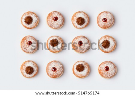Jewish holiday Hanukkah donut sufganiyot on white background. View from above. Flat lay